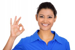 Closeup portrait of young  happy, smiling excited beautiful natural woman giving OK sign with fingers, isolated on white background. Positive emotion facial expressions symbols, feelings attitude