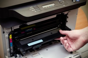 Close up of man puts toner in the printer